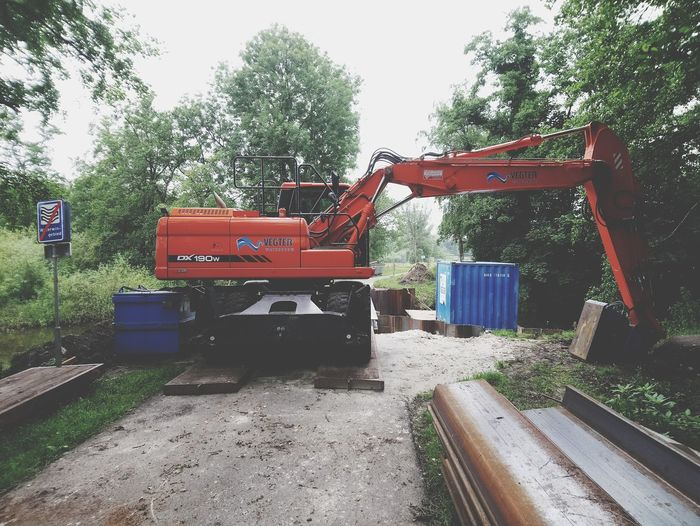 Excavator. Excavator Tree Sky Vehicle Trailer Construction Vehicle Earth Mover Road Construction Construction Equipment