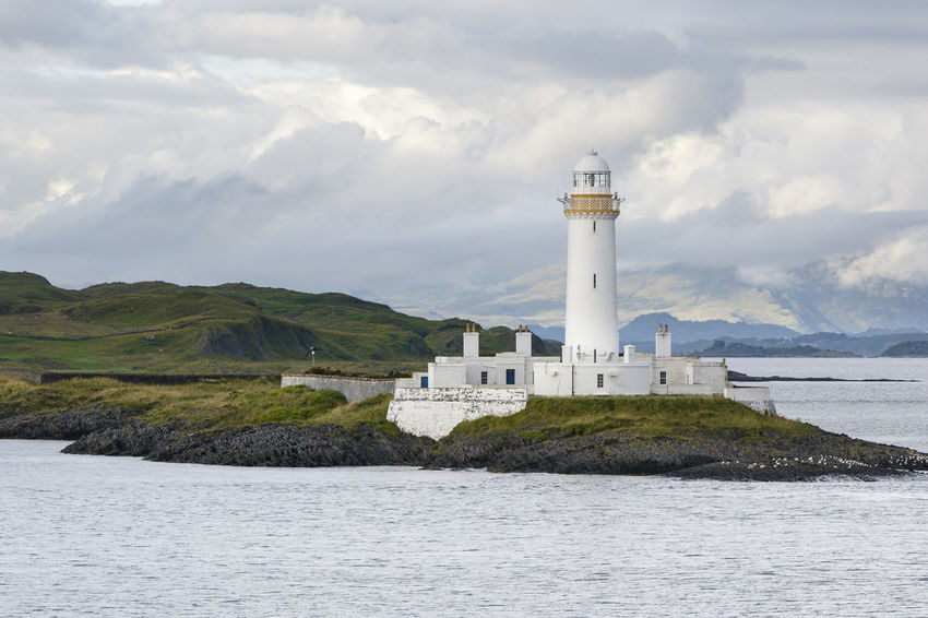 Oban, Scotland / United Kingdom - Jul 09 2017: Eilean Musdile Lighthouse. Aid Beacon Cloud Coastline Eilean Musdile Lighthouse Firth Lighthouse Loneliness Maritime Scotland United Kingdom Wave Weather Coast Hebrides Isle Landscape Maritime Security Navigation Sea Seascape Uk Wallpaper Warning Warning Sign