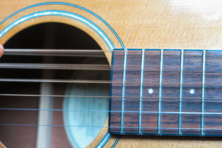 wavy string on an acoustic guitar Guitar Acoustic Guitar String
