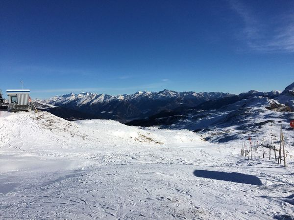 Beauty In Nature Blue Clear Sky Cold Temperature Copy Space Day Frozen Landscape Mountain Nature No People Outdoors Scenics Ski Lift Sky Snow Snowcapped Mountain Snowdrift Tranquil Scene Tranquility Transportation Weather White Color Winter
