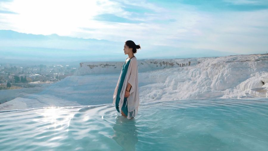 Peacefully morning in Pamukkale. One Person Water Sky Standing Cloud - Sky Nature Sea Scenics - Nature Leisure Activity Lifestyles Beauty In Nature Women Real People Adult Young Adult Outdoors Day The Great Outdoors - 2018 EyeEm Awards The Traveler - 2018 EyeEm Awards Side View Waterfront International Women's Day 2019