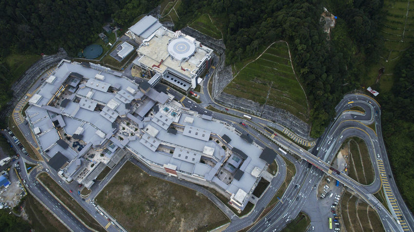 Aerial view of a shopping mall with complex traffic road on the mountain.Genting Premium outlet aerial view. Genting Highlands Shopping Aerial Aerial View Day Gpo High Angle View Nature No People Plant Road Shopping Mall Transportation Tree