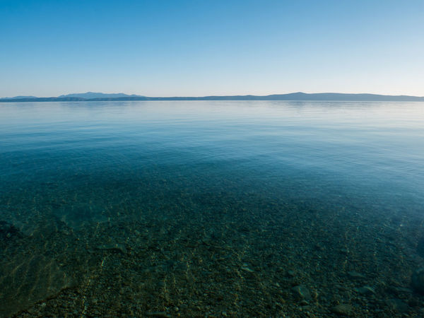 Crystal clear Adriatic sea landscape with island Hvar at background Adriatic Beach Beauty In Nature Blue Calm Clear Croatia Day Holiday Horizon Over Water Landscape Mediterranean  Nature No People Nobody Outdoors Scenic Scenics Sea Sky Summer Tranquility Travel Vacation Water