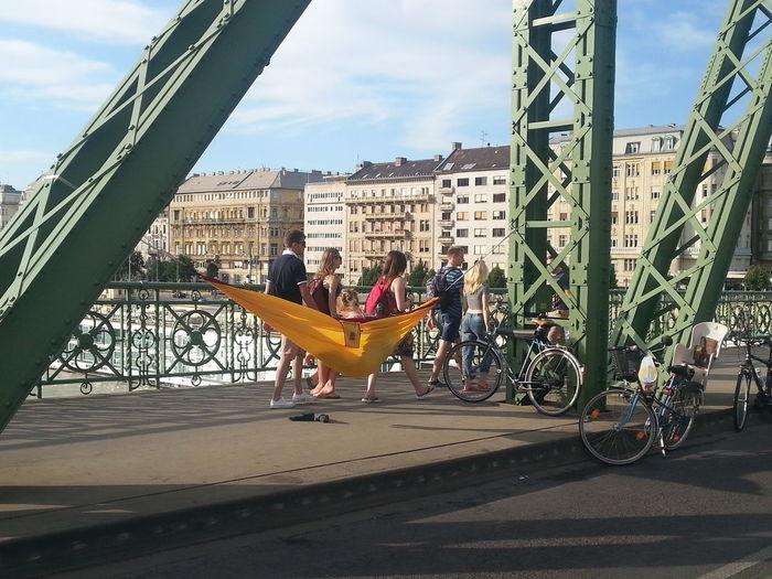 Hanging out on Freedom Bridge, Budapest, Hungary Bicycles Bridge, Budapest, Hungary Danube River Freedom Hammock Hanging Out, Photo, Enjoy Life Sunny Day Urban Lifestyle Yellow Hammock,