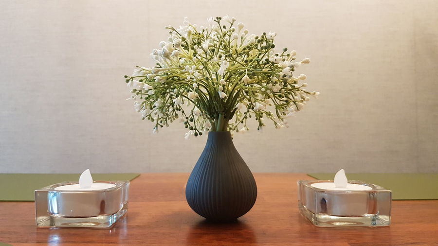 Close-up of vase on table at home