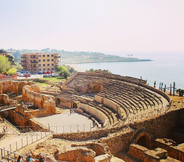 EyeEm Selectsancient Roman amphitheatre Sea Beach Horizon Over Water Water Day Outdoors Sunlight Sky No People Architecture Sand Nature Politics And Government Travel Destinations Travel City Architecture Clear Sky Nature Europe Travel Travel Photography Beautiful Tarragona Catalunya