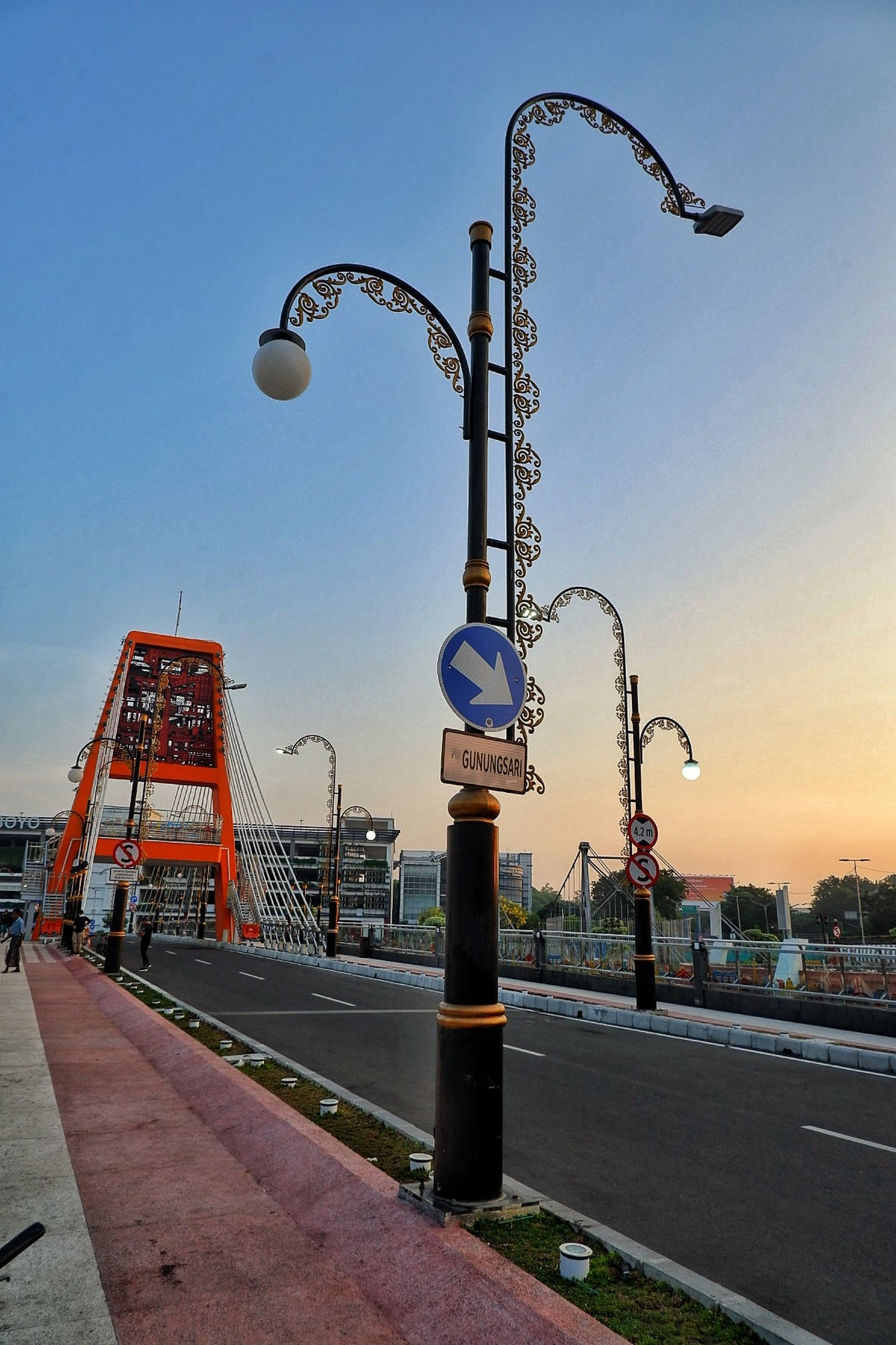 sky, street light, street, architecture, lighting equipment, nature, built structure, no people, city, clear sky, transportation, outdoors, road, day, sunset, metal, building exterior, machinery, dusk, footpath, construction equipment