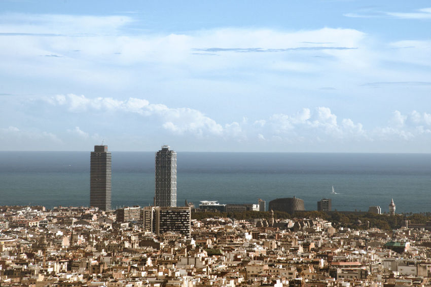 High density of houses in Barcelona city Sea Sky Architecture Cloud - Sky Building Exterior Horizon Built Structure Building Cityscape No People Outdoors Skyscraper City Mediterranean  Barcelona Horizon Over Water Hight Density