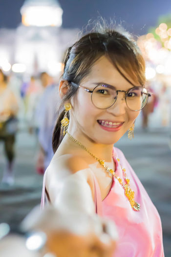 Thai Sty Thai Girl Thailand Beautiful Woman Emotion Eyeglasses  Focus On Foreground Front View Glasses Hairstyle Happiness Headshot Incidental People Leisure Activity Lifestyles Looking At Camera One Person Outdoors Portrait Real People Smiling Women Young Adult Young Women