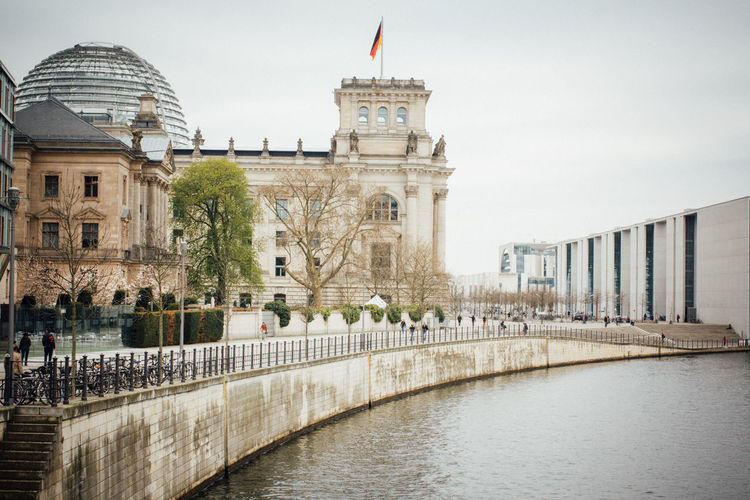 Spree River By Reichstag Building Against Sky
