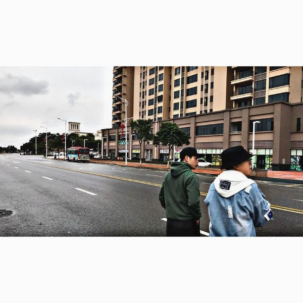 Two People Father Walking Building Exterior Real People Day Son Outdoors Hooded Shirt Love Built Structure Architecture Boys Women Road Adult Childhood