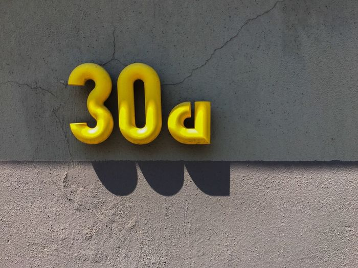 Close-up of number 30 on wall