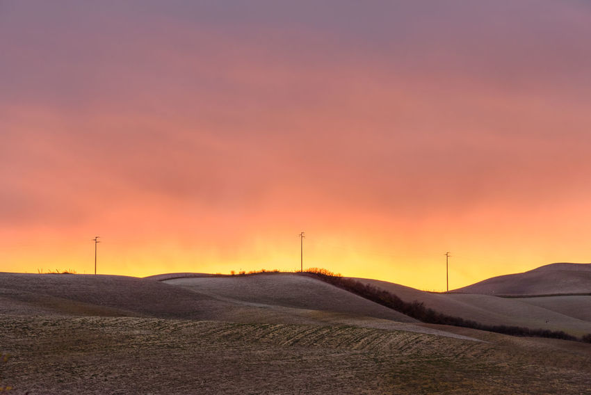 Last days of autumn Crete Senesi Torre A Castello Tuscany Tuscany Countryside Beauty In Nature Day Electricity  Landscape Mountain Nature No People Orange Color Outdoors Rural Scene Scenics Siena Sky Sunset Technology Tranquil Scene Tranquility Wind Power