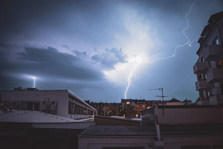 View of lightning over buildings in city