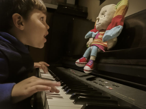 Lend me your ears and I'll Sing You a song... To Infinity & Beyond. arts culture and entertainment Child Doll Endearing Inseparable Music Musical Instrument Pianist Piano Playing Singing Song Toguether For Ever TakeoverMusic Piano Moments