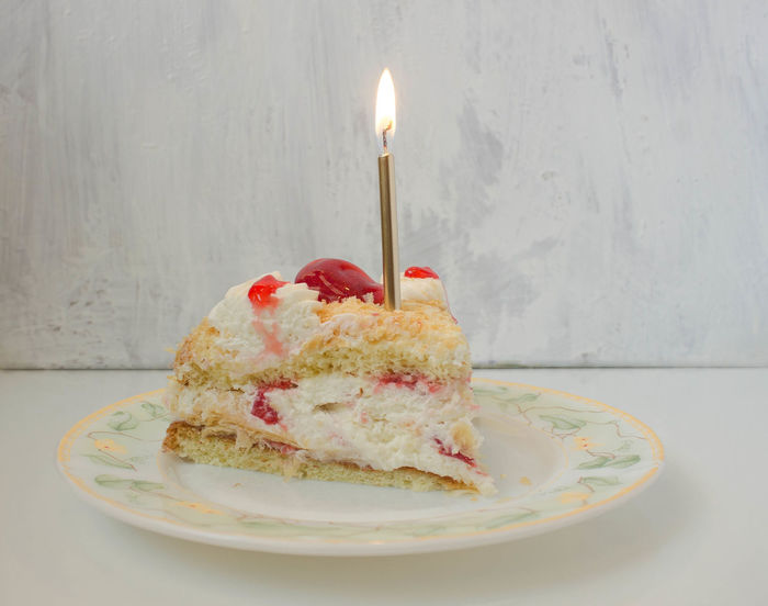Baked Birthday Candles Burning Cake Candle Celebration Dessert Fire Flame Food Food And Drink Freshness Illuminated Indoors  Indulgence No People Plate Sweet Sweet Food Table Temptation Unhealthy Eating