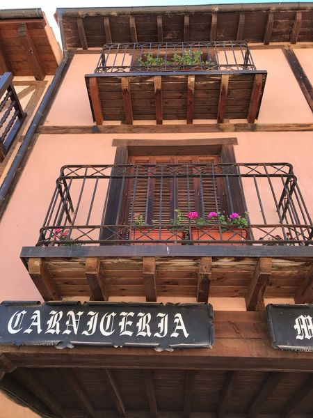 Balcones Flower Original Experiences Castilla Vacations Destination IPhoneography Pueblos De España No People Architecture Text Indoors  Communication Western Script Non-western Script Business Finance And Industry Arts Culture And Entertainment Built Structure Store Wood - Material Railing Script High Angle View Information Day Business