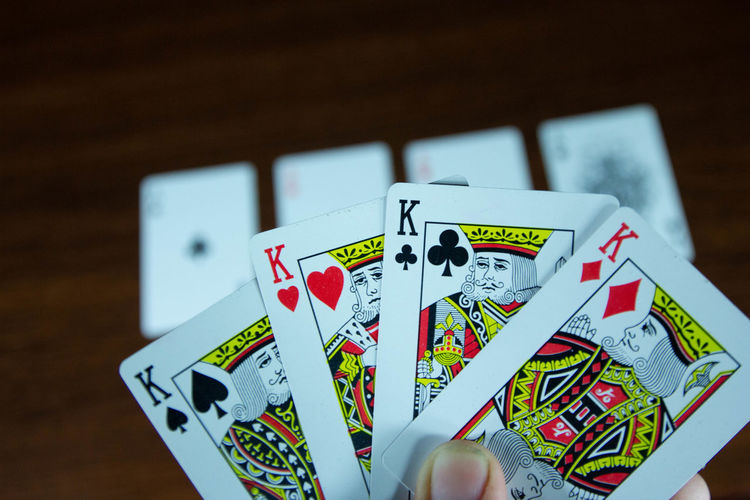 Arts Culture And Entertainment Cards Close-up Focus On Foreground Gambling Game Of Chance Indoors  Leisure Activity Leisure Games Luck No People Number Opportunity Playing Poker - Card Game Relaxation Selective Focus Still Life Table Text Wood - Material