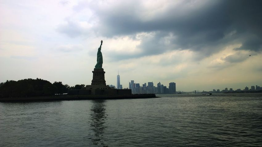 New York City No People Sea And Sky Sky And Clouds Skyline Skyscrapers Statue Statue Of Liberty Travel Destinations