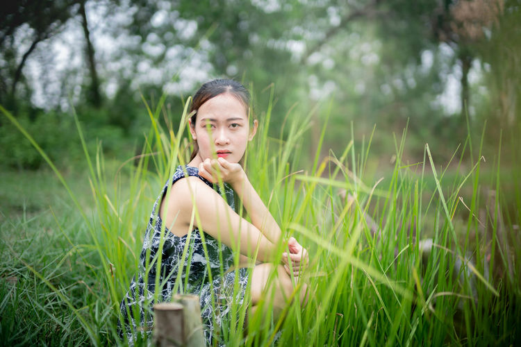 Plant Young Adult One Person Grass Portrait Leisure Activity Field Looking At Camera Lifestyles Land Real People Women Young Women Growth Nature Day Selective Focus Adult Beautiful Woman Contemplation Outdoors Hairstyle
