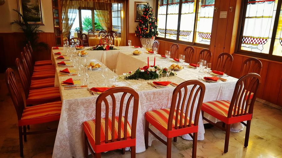 Chair Table Indoors  Furniture Dining Table No People Illuminated Lucariva Natale  Tavolata Tables And Chairs Christmas Time Christmas Decorations Christmas Table White And Red