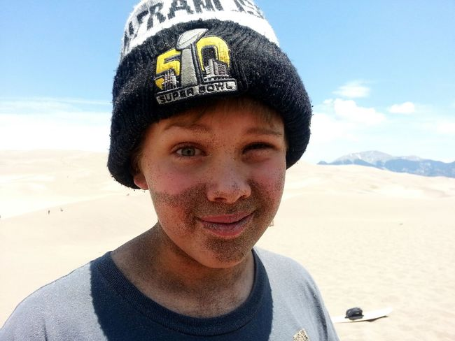 One of the kids at my church after being buried in the sand. I love his Sand Beard and Expression. Natural Light Portrait Boy Playing In The Sand Buried In Sand Great Sand Dunes Sand And Sun Wink Elfish The Portraitist - 2017 EyeEm Awards