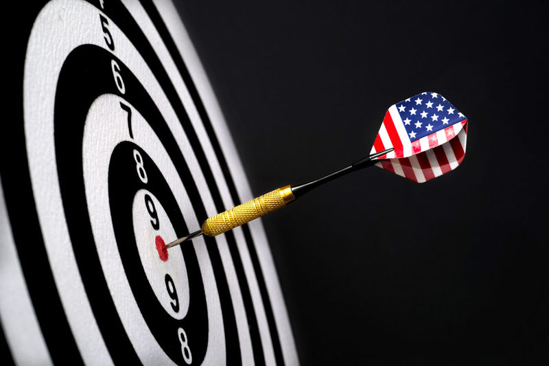 Center target of darts isolated on a black background Dartboard Bulls-eye Win Successful Center Public Metaphor Point Result Dart Targeting Victory Black Sport Board Mark Perfection Strategy Relations Conceptual Target Marketing Challenge Media Isolated American Circles Red Hit White Accuracy Objects Luck Accurate Perfect Arrow Patterns Ideas Game Flag Concept Direct Bull Success Eye Market Winner Background Play Studio Shot Sports Target Indoors  Close-up Number No People Shape Circle Geometric Shape Striped Achievement Leisure Activity Black Background Pattern Concentric
