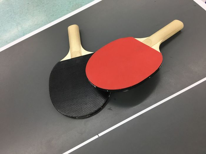 High angle view of rackets on table tennis table