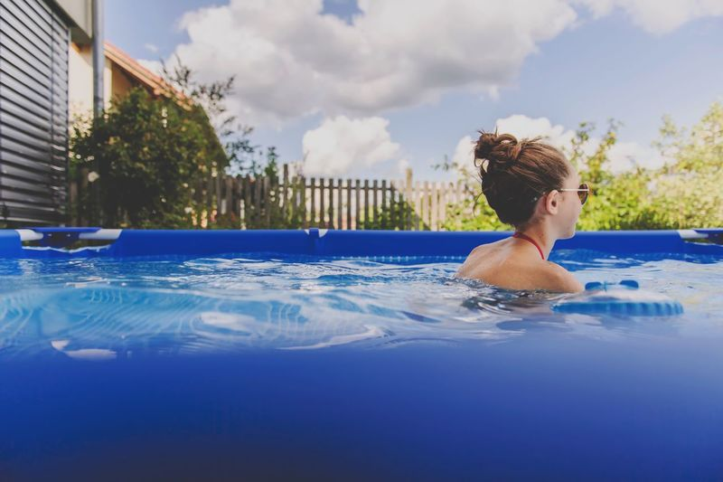 Swimming Pool Water Real People One Person Leisure Activity Day Lifestyles Outdoors Refreshment Architecture Rear View Building Exterior Built Structure Cloud - Sky Sky Women Headshot Swimming Young Women Young Adult EyEmNewHere