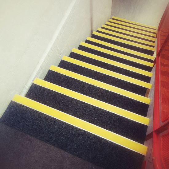 Stairs with yellow warning strips Yellow High Angle View Indoors  No People Steps And Staircases Day