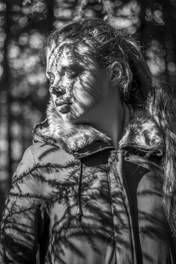 Young woman eyes closed while at forest