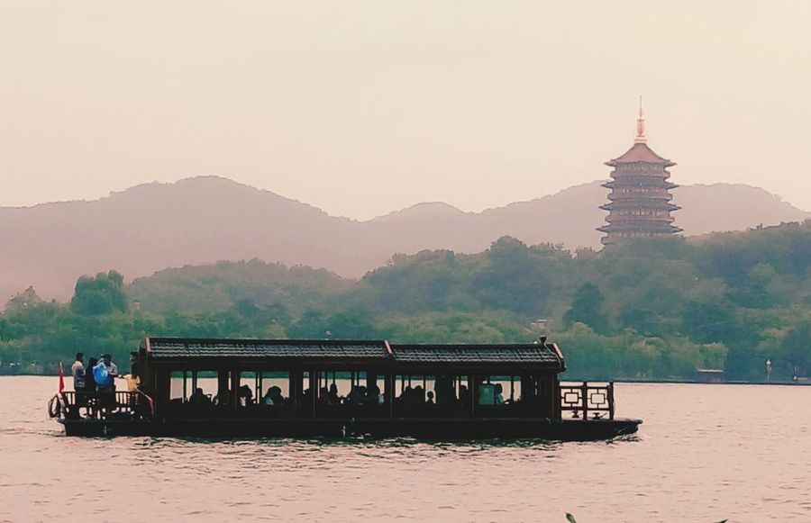 Mountain Mountain Range Water Tranquil Scene Waterfront Clear Sky Scenics Tranquility Beauty In Nature River Majestic Calm Nature Mountain Peak Vacations Non-urban Scene Outdoors Tourism Sky Hangzhou,China New Life New City XiHu Boat