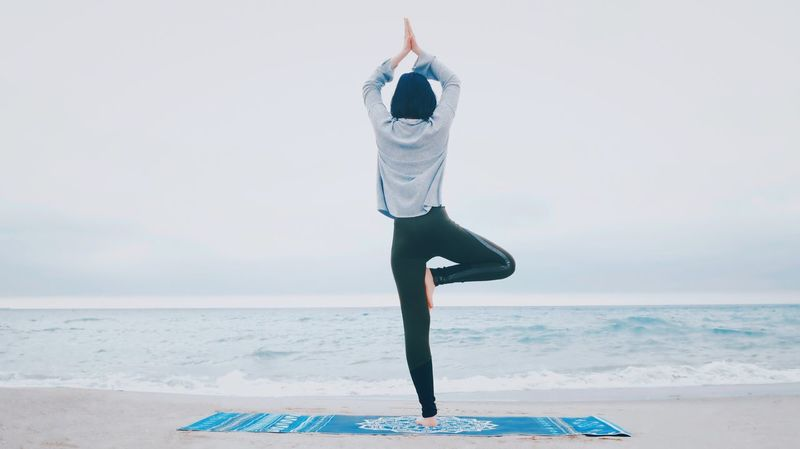 Sea Balance Horizon Over Water Exercising Water Yoga Lifestyles Full Length One Person Leisure Activity Healthy Lifestyle Real People Sky Wellbeing Beach Young Adult Women Sports Clothing Flexibility Standing