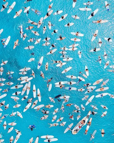 Directly above view of people in blue sea