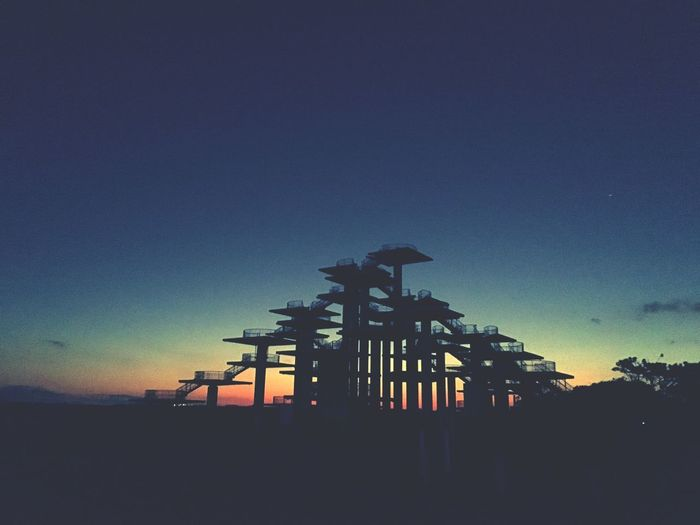 Beach Side Park Silhouette Architecture Built Structure Low Angle View Sunset No People Sky Blue Nature Outdoors Drilling Rig Moon Day