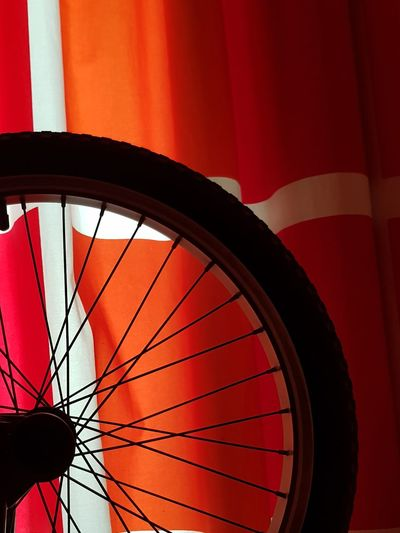 """Sings """"I want to ride my bicycle, I want to ride my biiiike"""" -Queen Red No People Day Indoors  Close-up EyeEm Gallery Bicycle Tire Ribs Orange White Sports Black Shadows & Lights Light And Shadow United Arab Emirates"""