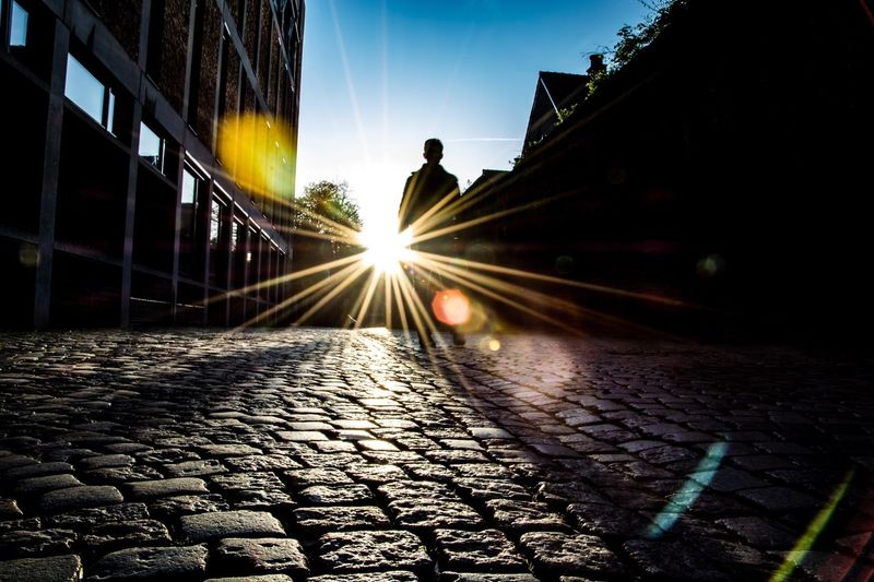 Something about the morning sun Silhouette Sunlight Sunlight And Shadow People Street Old City Cobblestone Building Exterior Guy Streetphotography Holland Maastricht Jeker The Street Photographer - 2016 EyeEm Awards