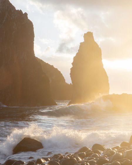 wild sunrise in Madeira Sea Water Beauty In Nature Rock Wave Sky Scenics - Nature Motion Rock - Object Land Nature Solid Sport Beach Rock Formation No People Aquatic Sport Non-urban Scene Outdoors Power In Nature Stack Rock Atlantic Ocean Rock Formation Waves, Ocean, Nature Waves Sunrise Sunlight Summer Blue Sky Calm Calmness Nature Landscape_photography Landscape