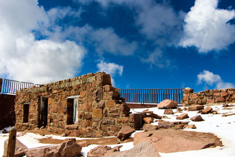Pikes peak ! Architecture Blue Building Exterior Built Structure Cloud Cloud - Sky Damaged Day Deterioration No People Obsolete Outdoors Pikes Peak Pikes Peak Summit Sky Solitude Stone Material Tranquility Weathered A Bird's Eye View Ice Age