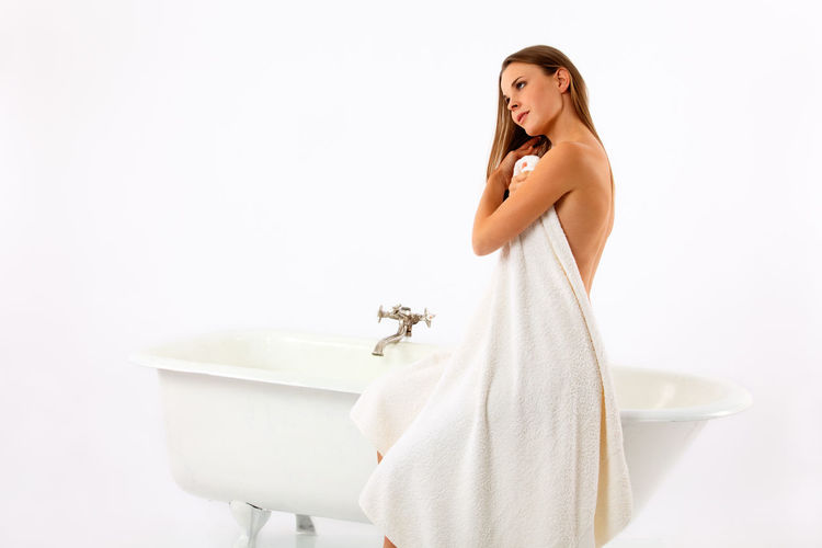 Woman in Bathroom Bath Bathing Natural Beauty Wellness Bathroom Beautiful People Beautiful Woman Beauty Body Care Freshness Hair Care Hair Style Luxury Natural Cosmetics Spa Towel Washing Hair Woman Bathing Woman In Bathroom