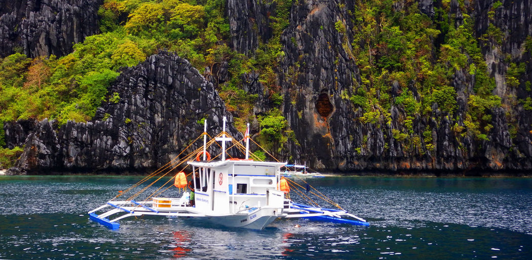 Diving Beauty In Nature Cliff Day Mode Of Transport Nature Nautical Vessel No People Outdoors Palawan Philippines Rock - Object Rock Formation Scenics Sea Tourist Destination Transportation Water