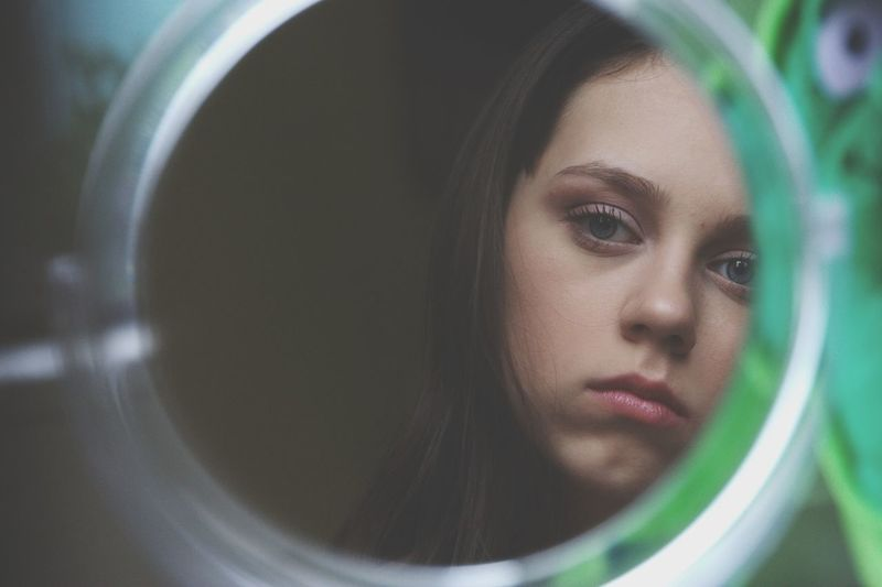Young woman reflecting on mirror