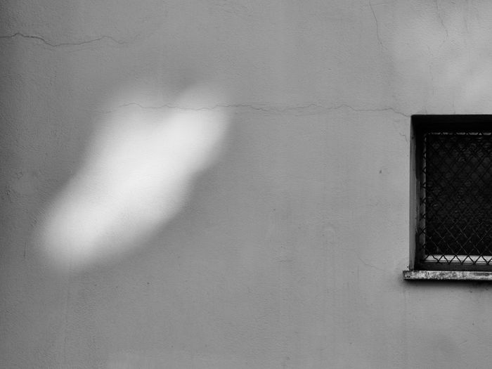 The City Light Blackandwhite Photography Daylight Photography Mood Lighting  No People Shadows And Light Texture And Surfaces The City Light Urban Walls Window