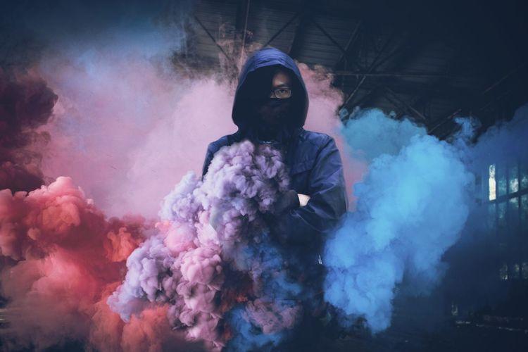 Portrait of man standing amidst smoke