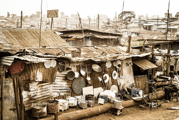 Small Business 3rdworld Kenya Nairobi Jua Kali Life In A Slum Kibera Slum KiberaStories Kibera Skyline Skyline Slum Social Issues Poor Living Condition Corrugated Iron Duka Sale Eisenwaren Hardware Shop Hardware Store Kitchen Utensil