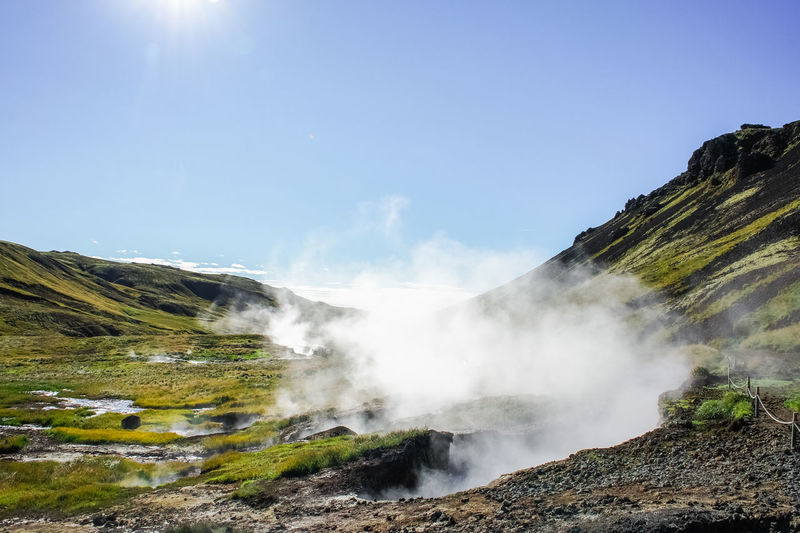 Valley of the river of Hveragerdi Iceland, small hot spring geyser on foreground. Geothermal Fields Iceland Beauty In Nature Day Geothermal  Geothermal Spa Hot Water Landscape Mountain Nature No People Outdoors Physical Geography Scenics Sky Tranquil Scene Water
