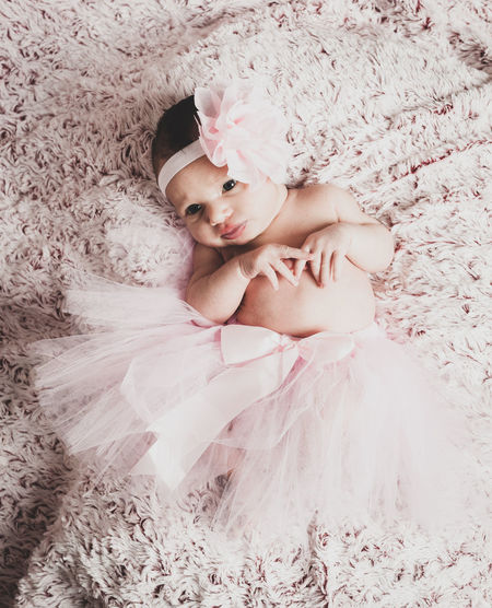 Newborn baby girl with tutu, ballet dancer. One Person Lifestyles Lying Down Real People High Angle View Relaxation Front View Leisure Activity Young Adult Bed Full Length Indoors  Women Young Women Furniture Resting Pink Color Comfortable Beautiful Woman Innocence Newborn Ballet Dancer Tutu Pink