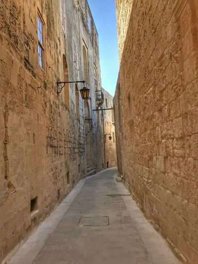 Narrow alley in Rabat, Malta Alley Alleyway Architecture Building Exterior Built Structure Day Narrow Narrow Street No People Outdoors Sky The Way Forward