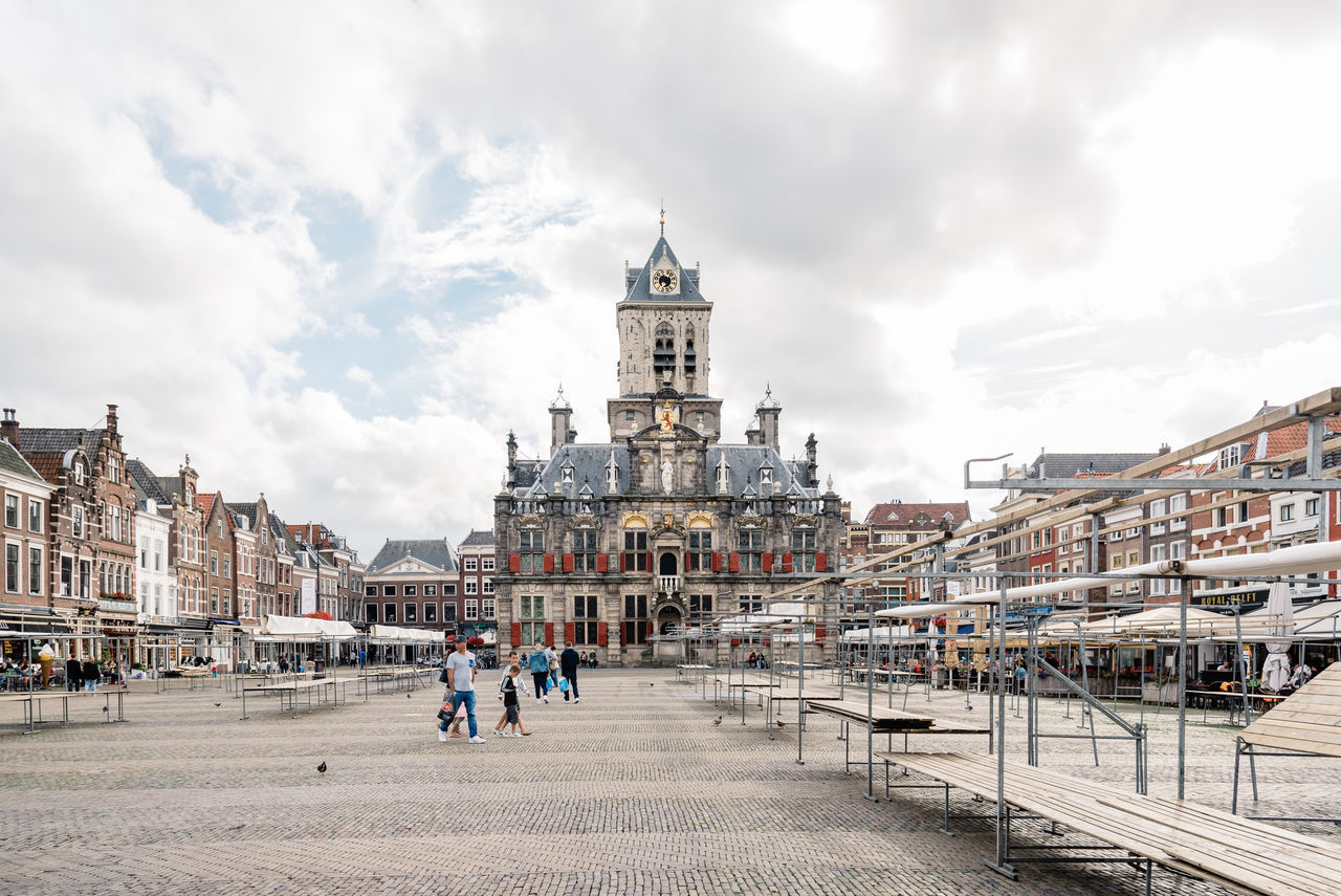 architecture, built structure, sky, cloud - sky, building exterior, real people, history, spirituality, day, travel destinations, religion, place of worship, outdoors, large group of people, men, women, city, people