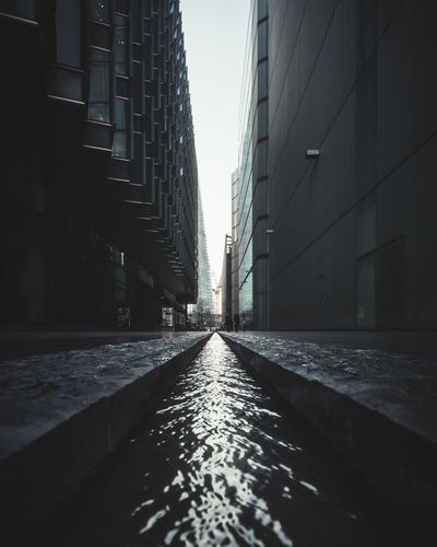 Flow London Alley Architecture Building Building Exterior Built Structure City Day Diminishing Perspective Direction Nature No People Office Building Exterior Outdoors Rain Road Sky Street Surface Level The Way Forward Transportation Water Wet